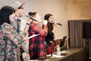 Left to right: moderator Rita Meade and performers George Salazar, Ryann Redmond, and Isabel Santiago lead the audience for the Bookish Broadway Sing-Along.