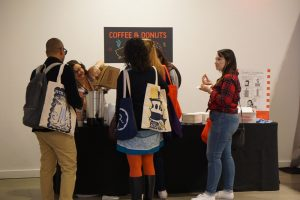 There's always a crowd around the coffee and donuts table!