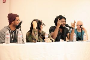 Young poets from Urban Word joined author Jason Reynolds (second from right) and poet Vincent Toro (right) for a panel on spoken word.